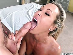 Blonde Brandi Love is curious about oral sex with hard dicked dude