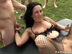 Samy Saint and her Milf friend are up for some fun under the sun in the garden. They´re gangbanged outdoors and enjoy a fine warm bukkake to top it off in style!