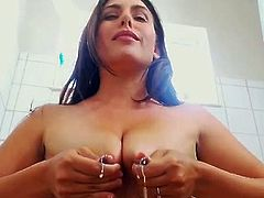 Hot beautiful young mom ponded her horny pussy with huge dildo and at the same time fucked her butthole with smaller one very deep and hard.Since she felt very dirty after her hot masturbation,she decided to have a nice hot shower.She started milking herself squeezing her perfect tits and spraying hot milk all aroung her bathroom.Than she quickly blowjob and deepthroat a huge dildo and started pounding her horny pussy again very deep and hard while she was showering.That was not enough for her horny holes so she took a black butt plug and penetrated her butthole again very deep after she stret