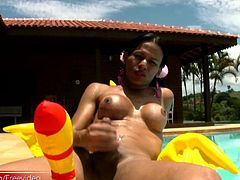 Exotic looking shemale Lohane Silva was working on tanning her already dark skin and playing in warm water. As we watched, she took off of her swim suit and started stroking her big hard dick...