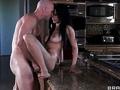 Johnny Sins is one hard-dicked guy who loves fucking Isis Love with gigantic melons
