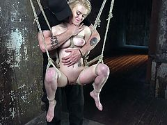 Anna is the object of her executor's actions for the evening, and she is getting a great treatment. She's suspended in the air, almost in a sitting position, getting her nipples pained and her pussy pleasured.