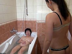 Horny lesbian masturbate her pussy in the bathroom