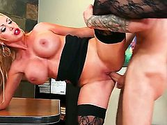 Nikki Benz is a mature blonde that has caught one of her employees jerking off during work out. She put a stop to that behavior by having sex in office.