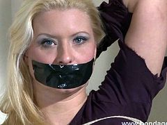 Tape gagged German fetish model Melanie Moons bondage and lesbian rope works of mistress Xinran on busty damsel in distress