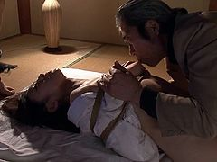 Imagine being in a dimly lit room and having your way with any one of these sexy milfs. One of the sluts is tied up tightly in rope. Men play with her cunt and nipples, one guy gets ready to cum on her face, as the other milf looks on in a demeaning way. She is clearly ashamed of his perversion.