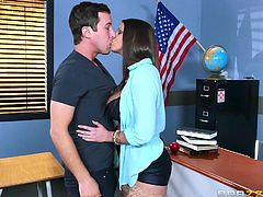 When Jessy see the huge tits his teacher has, he instantly gets a hard on. She is always teasing him with her cleavage. One day, during tutoring, she took the plunge and sucked on his hard dick. He gets his face in between her boobs. What naughty fun in the classroom!