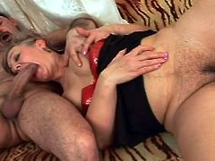 A chubby mature lady exposes her unshaved cunt to her horny partner. The blonde granny seems extremely turned on and eager to play dirty. Click to watch her spreading legs widely and sucking cock with enthusiasm.