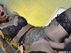 Being left alone with Danny, this sexy tattooed milf can't miss the chance to have fun... The busty blonde is eager to entertain the guy, and appears in front of him, wearing just black kinky lingerie on. Watch hot Kleio, sucking dick and playing dirty!
