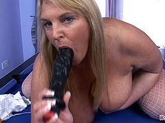 BBW Carol Brown plays pool with her pussy