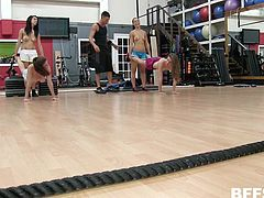 Four best friends working out in a gym, catch the eye of a hot muscular guy. They get naked while working out and things change quickly, from lifting weights, to lifting his balls and licking each others pussy's.