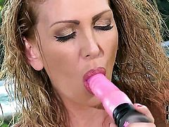 Milf Leigh Darby with big melons and trimmed twat screams as she fucks herself with toy