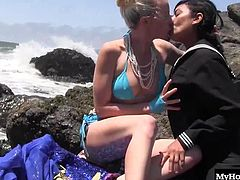 Lorelei Lee was enjoying the salty air at the beach when she spotted the beautiful mermaid Beretta James Her tail chaned into legs and she was able to have hot lesbian interactions with Lorelei behind a graffitied rock.