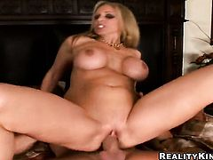 Blonde harlot Julia Ann with juicy hooters shows it all and then masturbates in closeup