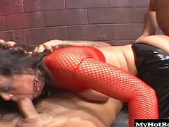 De Bella is dressed in a red fishnet top and comes crawling up to two guys who throatfuck her. She sucks and wanks on their cocks, then fucks them in a seedylooking warehouse. She rides the cocks steadily and gives them a great screw until theyre popping their loads in her mouth.