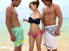 Beautiful Japanese babe gave a perfect blowjob to the guys out there, on the beach. She sucked one dick and seduced the other, by pressing her mighty ass against his cock. She was really enjoying the scenery and the dicks in her mouth and ass.