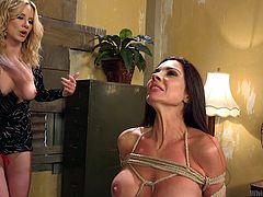 Madeline Marlowe never accepts indiscipline and decided to teach a lesson to Kirsten Price, who holds the REAL BAD ASS image in office. Madeline ordered her to come to her home and tied her with ropes. She whipped her boobs, ass and other sensitive parts, and destroyed her pussy with a big strap-on.