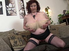 Sexy housewife Jana P. plays with a dildo