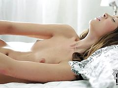 Teen Tini with tiny breasts and hairless bush makes her sexual fantasies cum true in solo action