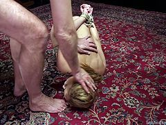 She was slapped, whipped and fucked in that round ass. Her master felt that she need to learn more lessons on obedience and he asked her to lick his feet, which she obliged unwillingly. Later, she was tied-up and punished hard for her unacceptable behavior.