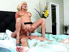 Blonde latin vixen Tara Holiday with big tits and shaved bush fulfills her sexual needs and desires with dudes throbbing love wand in her wet hole