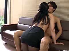 This busty Japanese chick tried to motivate her co-worker, by doing some naughty things with him in the office. She grabbed his dick and sucked him on her knees. Then, she got undressed, kissed the guy and made him suck her boobs.