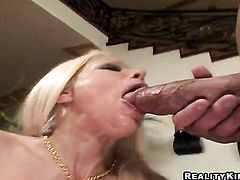 Blonde Gina Lynn with huge knockers and clean snatch turns man on to the point of no return with her hands and jerks him off