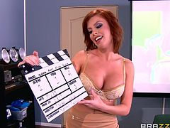 Busty redhead Britney, is the teacher of anatomy. Soon she will lead the seminar, but there are not enough of visual aids, so she invites her best student to help her. But everything went wrong... Watch Britney sucking her student's dick and balls, on knees, at school. Have fun and enjoy impetuous sex action!