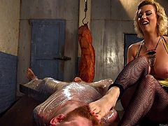 Cherry Torn always love to dominate men and Sebastian Keys was her new slave. She slapped his face, wrapped him in plastic, tied him up and ordered him to lick her feet. She fucked his ass with a strap-on and denied permission to cum. After she was satisfied with him, she gave him a hand job.