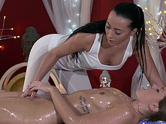 I just joined the massage parlor and boss told me to satisfy the customer. She got naked and asked for a lesbian sex. I dropped oil on her boobs, massaged them hard and started to rub her oily pussy slowly. Then I undressed myself, rubbed my boobs on her chest and inserted two fingers in her tight cunt.