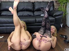Extravagant pair of blondes using a vibrator on the comfy couch