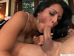 Sexy milf Kiara Mia in fishnet stockings blow and deepthroats a big young cock and gets fucked in her bedroom receiving warm sticky cum at the end.