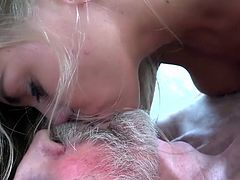 A stunning looking young blonde wanted to take a shower and caught an old wrinkled man masturbating thinking of her. He took his cock and started to suck it and spread her legs so the grandpa can fuck her pussy and finish his cum on her.