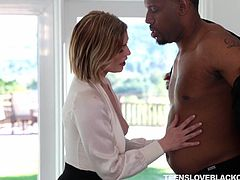 The sight of a massive black cock makes this hot babe quiver from anticipation. She gets her ebony boyfriend really hard and slurps all over his huge penis. Blonde white girls like this, are always addicted to a really massive cock.