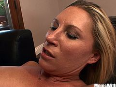 Busty blonde housewife Devon Lee is playing with her pierced pussy on the couch and gets deep fucked when her husband arrived.