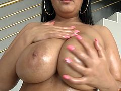 Jasmine Black has a huge pair of melons and is ready for a cock ride