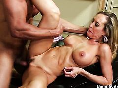 Blonde Brandi Love parts her legs to take hard dick in her beaver