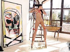 Gina Devine gives herself some slit stimulation with the help of her dildo