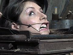 I had never saw such a perverted torture. Placed in a special box under the floor, which looks like a cage, Dee was brutally humiliated. Her nose and mouth were stretched with a special device, while her mouth was stuffed with a black dildo. She cannot withstand, as only her head is on the surface. Tough Domination!