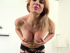 Glass dildo deep in her pussy and vibrator on her clit