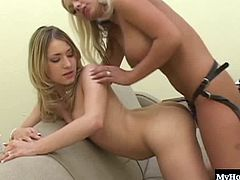 Kayla Marie and Roxy Ryder are both blondes however, one has been a lesbian for some time now and has a tongue piercing, along with another in her naval and youll get to see it, after she takes off her panties and sits on her huge boobed girlfriends strap on, after they practice using various sex toys in each others twats while in different positions.