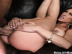 Brunette with gigantic breasts is too hot to stop the cock stroking session