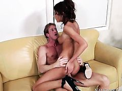 Brunette August Ames with small bottom and smooth twat has fire in her eyes as she takes pop shot on her lovely face