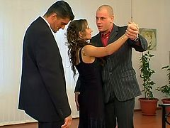 To get the deal done she ends up fucking two guys at once