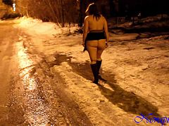 Oxy naked in the street walking in the snow