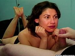 Pretty girl in pink lipstick gives a sexy handjob