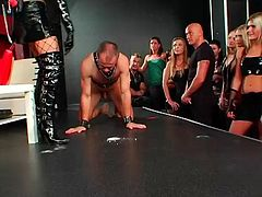Dude acts slave in a thrilling femdom sex at the club in a reality shoot