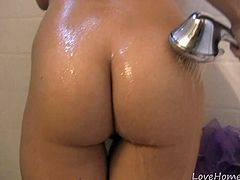 Girl with the stunning body takes a shower