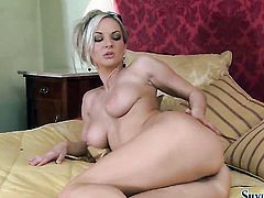 Blonde Silvia Saint proves that her body is perfect as she masturbates naked