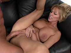 Giddy milf with big tits gets plowed hardcore on the couch